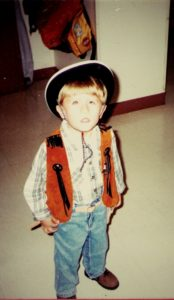 Young Alex dressed as a cowboy